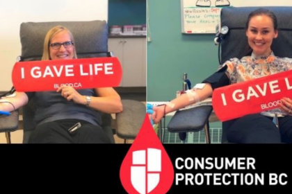 Picture of two of our staff from our Victoria office giving blood